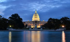 Washington DC, US Capitol Building in a cloudy sunrise with mirr